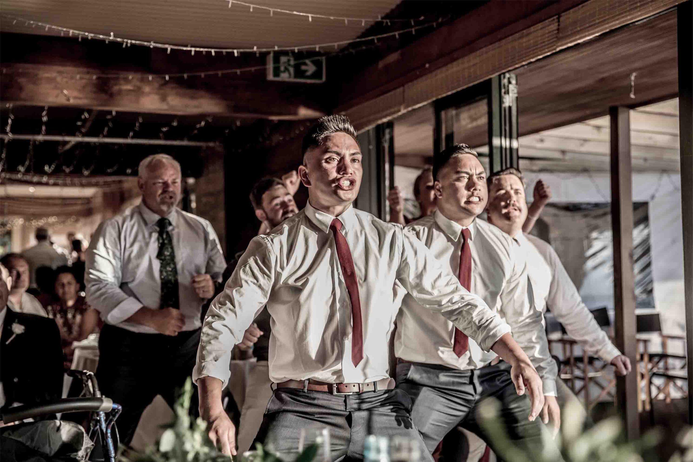 guests cheering at wedding reception