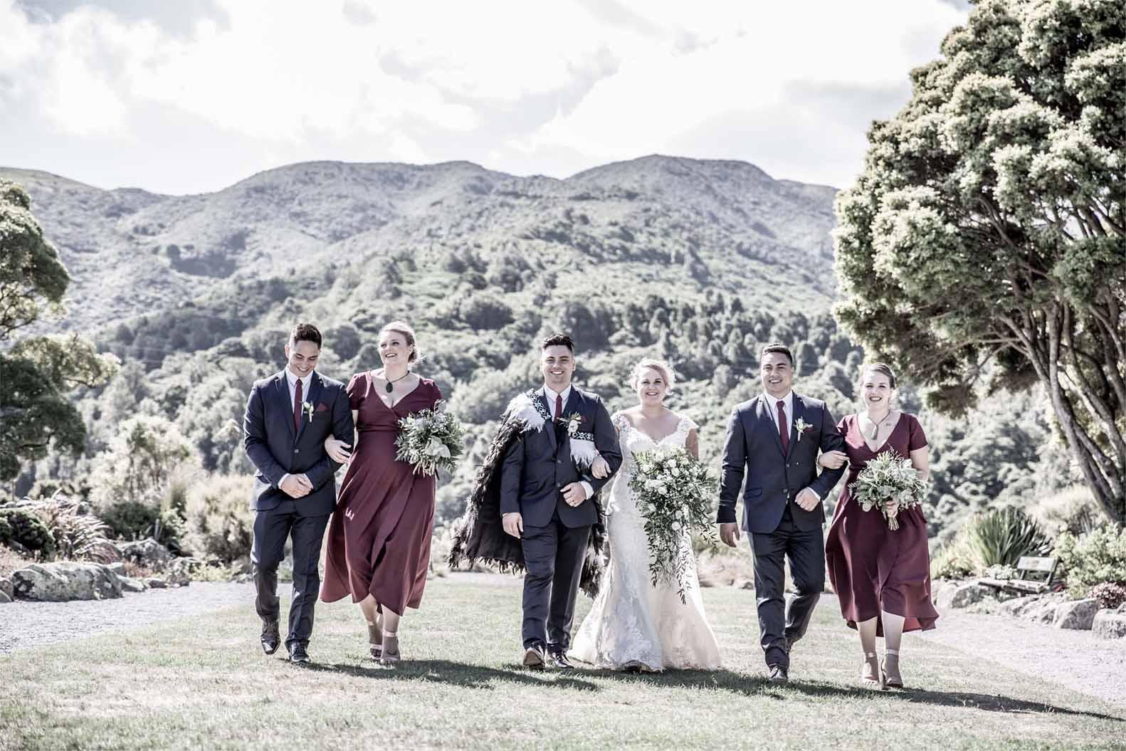 bridal entourage walking down a wide lane