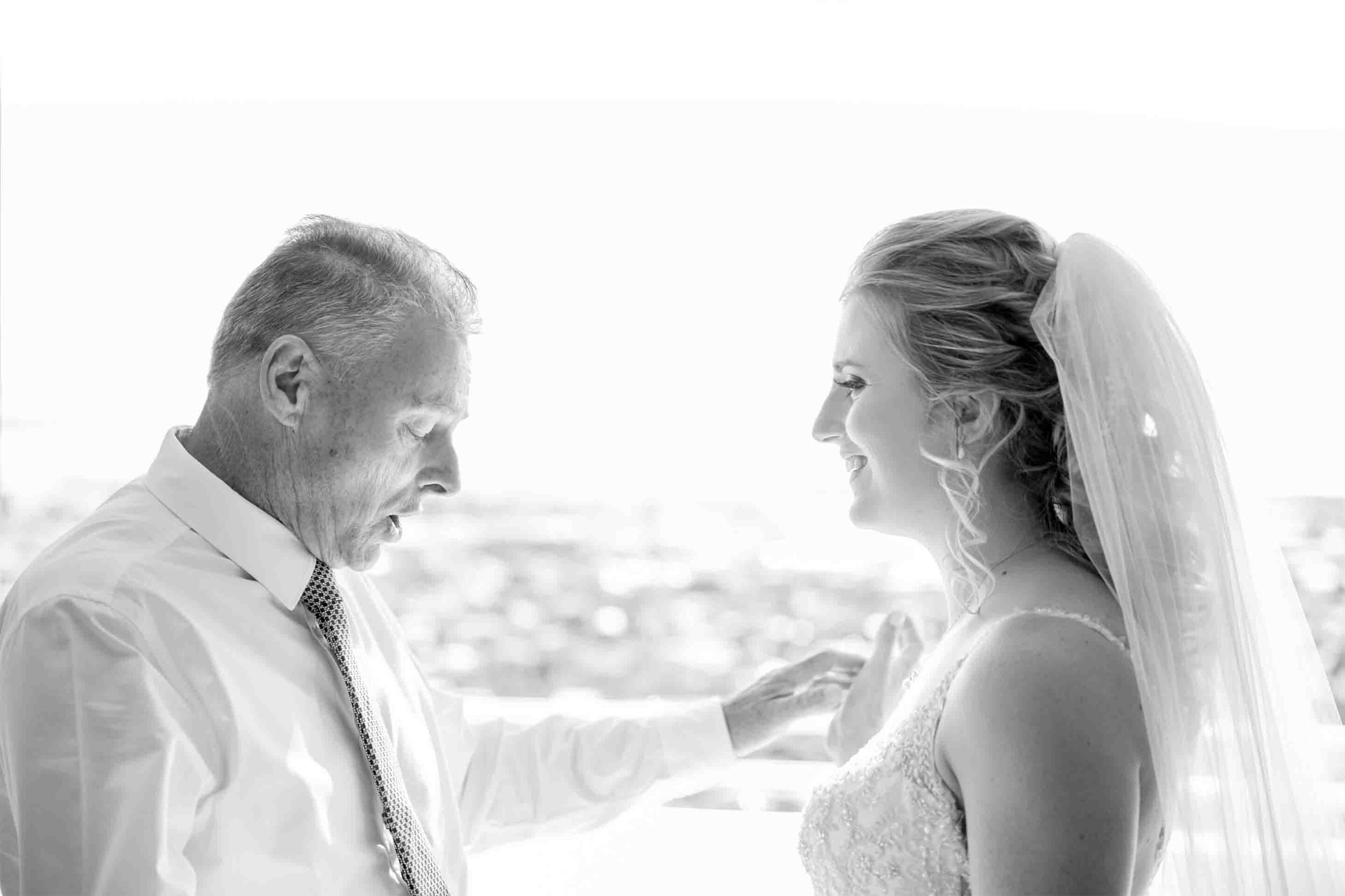 father and bride standing face to face